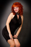 Red-haired girl in a black dress Stock Photo