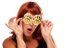 Red Haired Girl with Bling-Bling Dollar Glasses. Isolated on a White Background stock images