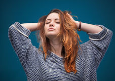 Red-haired girl on blue background. Stock Photography