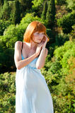 Red-haired girl in a blue dress Royalty Free Stock Photo