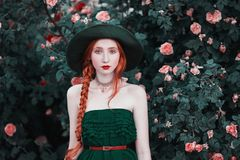 Woman with pale skin and long red hair stock images