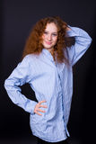 Red-haired girl in a blue shirt. Beautiful red-haired girl in a blue shirt Stock Photo