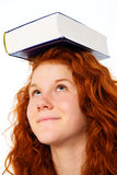 Red-haired girl with book Royalty Free Stock Photo