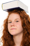 Red-haired girl with book Stock Photos