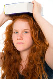 Red-haired girl with book Stock Photography