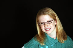 Red haired girl with braces and glasses. Pretty redhead young girl in glasses with braces Royalty Free Stock Photography