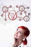 Red-haired girl chooses the best idea stock photos