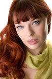 Red haired girl close-up. Red haired girl and a scarf close-up Royalty Free Stock Image