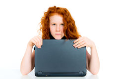 Red haired girl with computer Stock Photo