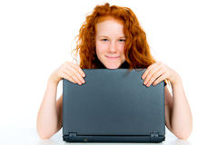 Red haired girl with computer Stock Photos