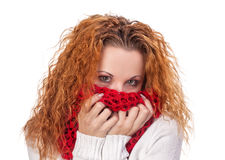 Red-haired girl covers her face with scarf Royalty Free Stock Photography
