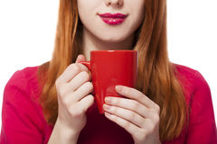 Red-haired girl with cup. Stock Photos