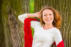 Red-haired girl with curly hair Royalty Free Stock Images