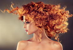 Red haired girl with curly hairstyle. Royalty Free Stock Photography