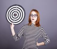 Red-haired girl with dartboard. Royalty Free Stock Photography