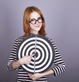 Red-haired girl with dartboard. Royalty Free Stock Photo
