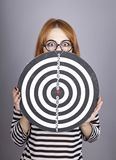 Red-haired girl with dartboard. Stock Photography