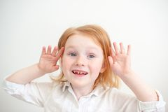 Girl with dental caries. Red-haired girl with dental caries Stock Photography
