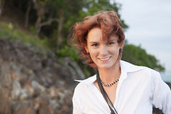 Red-haired girl. The red-haired girl in desert island Stock Photography