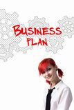 Red-haired girl is developing a business plan Royalty Free Stock Photo