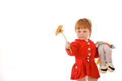 Red-haired girl with doll Stock Photos