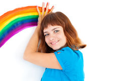 Red-haired girl draw rainbow by palm. Red-haired teenager girl draw rainbow by palm. Isolated on white background Royalty Free Stock Photography