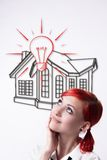 Red-haired girl dreams of your own home stock photos