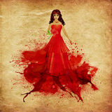 Red haired girl in dress of paint Royalty Free Stock Photography