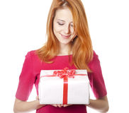 Red-haired girl in dress with present box Royalty Free Stock Photography