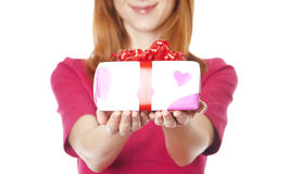 Red-haired girl in dress with present box Stock Images