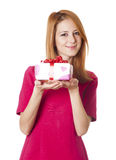 Red-haired girl in dress with present box at white background. Stock Photos