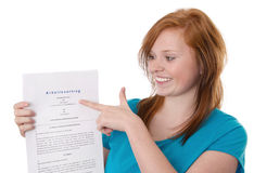 Red-haired girl with employment Royalty Free Stock Images