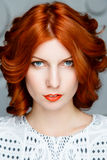 Red-haired girl face Stock Image