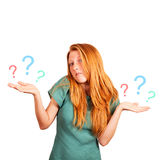 What to choose?. Red-haired girl facing a choice isolated on a white, holding a questions marks at her hands Stock Photography