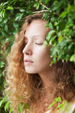 Red-haired girl fairy in nature Stock Image