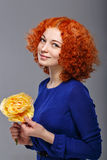 Red-haired girl and flowers Royalty Free Stock Photography