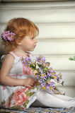 Red-haired girl with flowers Stock Photos
