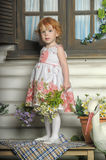 Red-haired girl with flowers Royalty Free Stock Images
