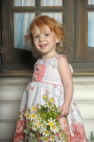 Red-haired girl with flowers Stock Photo