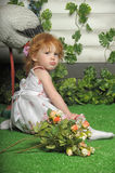 Red-haired girl with flowers Royalty Free Stock Photography