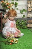 Red-haired girl with flowers Stock Images