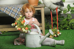 Red-haired girl with flowers Royalty Free Stock Photo