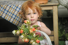 Red-haired girl with flowers Royalty Free Stock Photos