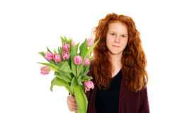 Red-haired girl with flowers Royalty Free Stock Image