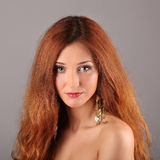 Red haired girl with flying hair Stock Photo