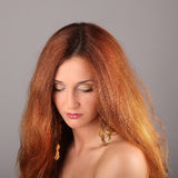 Red haired girl with flying hair Royalty Free Stock Images