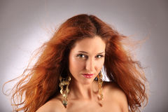 Red haired girl with flying hair Royalty Free Stock Photos