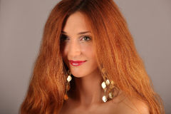Red haired girl with flying hair Stock Photography