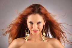 Red haired girl with flying hair Stock Images