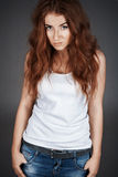 Red-haired girl with freckles in the studio. Royalty Free Stock Photography